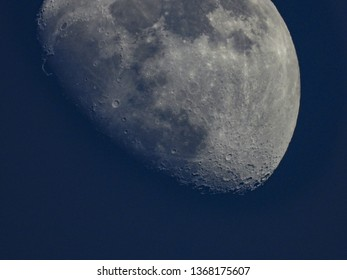 Moon by day, detailed craters visible