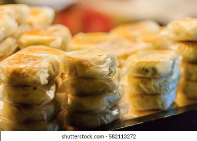 Moon cake or Chinese ancient dessert called 'Pia',ancient dessert Made from flour to Baking heat Mashed golden beans stuffed with salted egg yolk,Chinese pastry or moon cake.