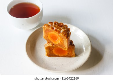 """Moon cake for Mid autumn festival with cup of tea. Chinese traditional food and dessert. ( Moon cake is call """" yue bing """" in chinese language)"""