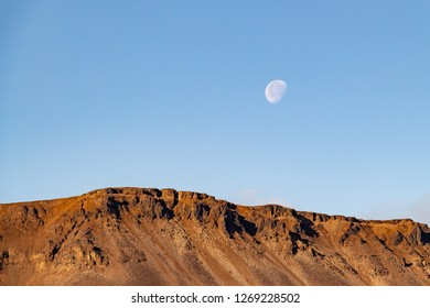 The moon in the clear blue sky over the mountain, August 31, 2018, Norilsk