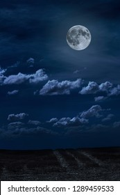 Moon and clouds in the night. Moonlight and road background. Dark blue backdrop.