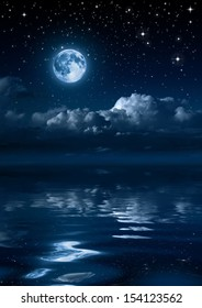 moon and clouds in the night on sea