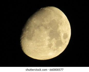 Moon in dark black sky at night