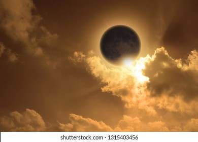 The moon darkens the sun and the sky is bathed in orange light