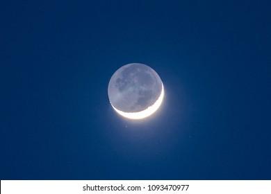 Moon First Quarter Third Quarter with blue sky.