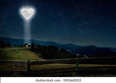 The moon heart-shaped shines over the lovers' house on valentine's day  - Shutterstock ID 1901642053