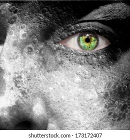 Moon image superimposed on a man's face with green eye - elements of this image furnished by NASA