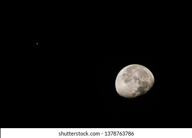 Moon with Jupiter ascending with two moons