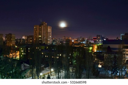 The moon and the landscape of winter city.