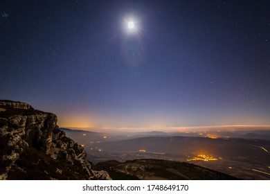 Moon and mountains in Serra Del Montsec, Lleida, Spain
