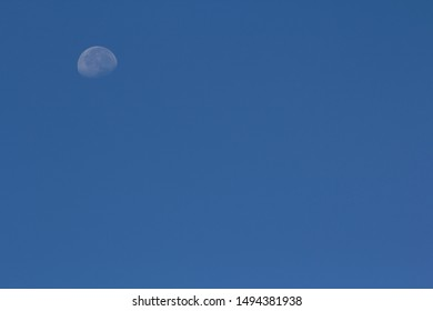 The Moon on Beautiful Blue Sky. Copy Space for Text.