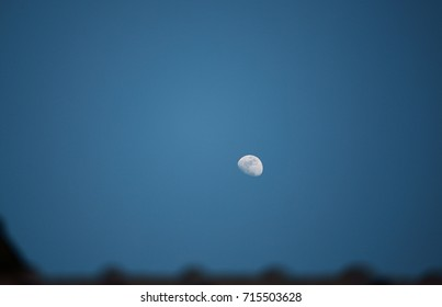 Moon on blue sky in the night.