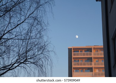 Moon over apartment house