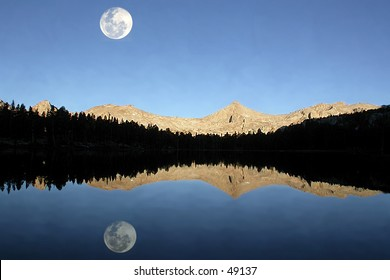 Moon over lake and mountains
