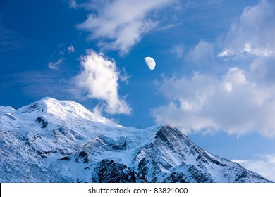 Moon over Mont Blanc. Mont Blanc, Chamonix, French Alps. France.