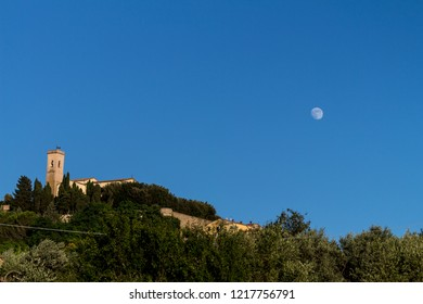 Moon over Montescudaio in tuscany