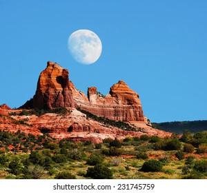 Moon over Red Rock country mountains surrounding Sedona Arizona