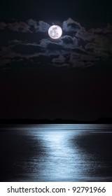 Moon over sea at night