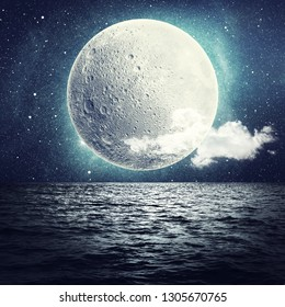 Moon over sea surface with reflection. Elements of this image furnished by NASA