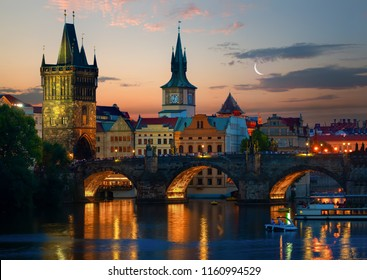 Moon over towers on Charles Bridge at sunset, Prague
