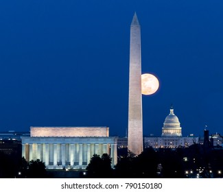 Moon over Washington, D.C. with Lincoln Memorial, Washington Monument and U.S. Capitol with a dark blue sky
