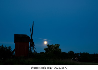 Moon over windmill and blossom elder tree
