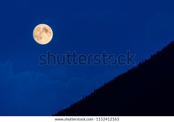 Moon rise over the mountains.