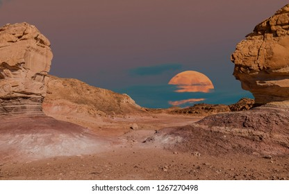 Moon rise and volcanic landscape in geological Timna park, Israel. It is located 25 km north of Eilat and combines beautiful scenery with unique geology, variety of sport and family activities