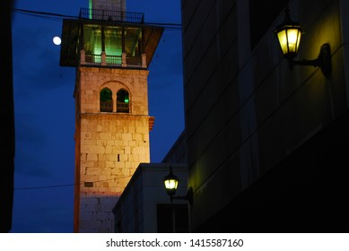 The moon rises behind a minaret of The Umayyad Mosque/Great Mosque of Damascus/. The mosque has spectacular and beautiful lighting. Syria before the war. Damascus, Syria,Middle East. November 22, 2007