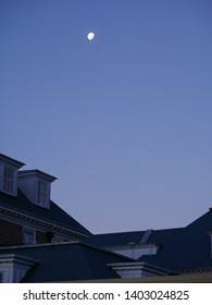 Moon rises over the chateau at Mt Ruapehu, New Zealand at dusk.