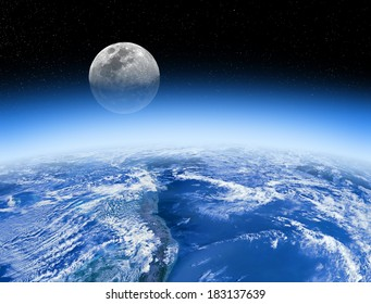 Moon rising behind the Earth's atmosphere. Small stars are in background. Planet furnished by NASA/JPL.