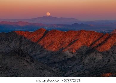 Moon rising over the four peaks mountain as seen from Piestewa peak , phoenix, Arizona. Scenic USA landscape.