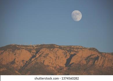 Moon rising over Sandia mountains ABQ, NM