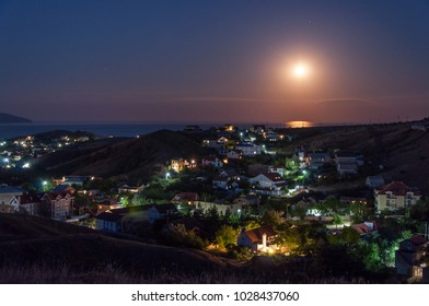Moon rising at sea. Crimea. Koktebel.