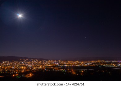 Moon, Saturn and Jupiter above the City