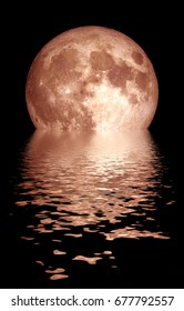 Moon setting over water.