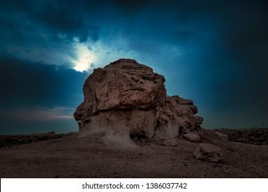 Moon shining  on Rock -Dammam Saudi Arabia desert.