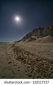 Moon shining on a sandy beach