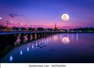 The moon stunt above Kaen Nakhon Park,Khon Kaen, in the twilight.