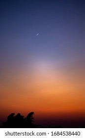 Moon at sunset in a very clear weather in Belgium