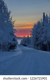 Moon and sunset in winter Finland Laplandia with trees under snow