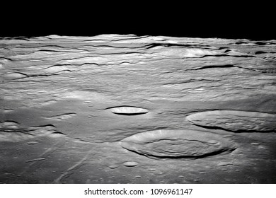 Moon Surface. Image of the Moon showing landing site of Apollo 11 around center of the Moon. Elements of this image furnished by NASA