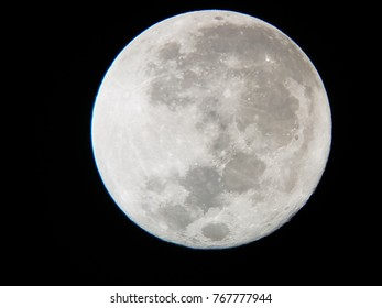 the moon viewed through a telescope