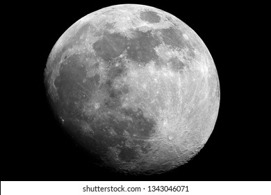 Moon in waxing gibbous phase taken by telescope in th dark space.