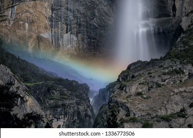 Moonbow or Lunar rainbow and star at Yosemite Lower Falls during a full moon in Yosemite National Park, California, USA