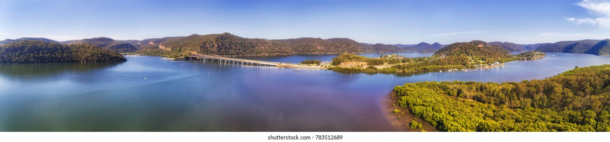 Mooney Mooney fishing village on Hawkesbury river near bridge on Motorway 1 from Sydney to Newcastle in elevated aerial panorama on a sunny day.