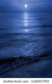 Moonlight at the beach reflecting on the waves
