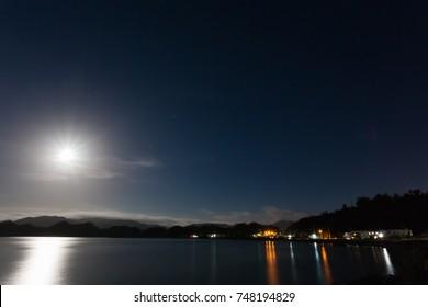 The moonlight lights the sea