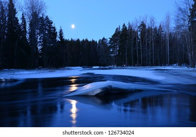 Moonlight on the river in winter