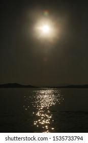 Moonlight over the dark ocean water